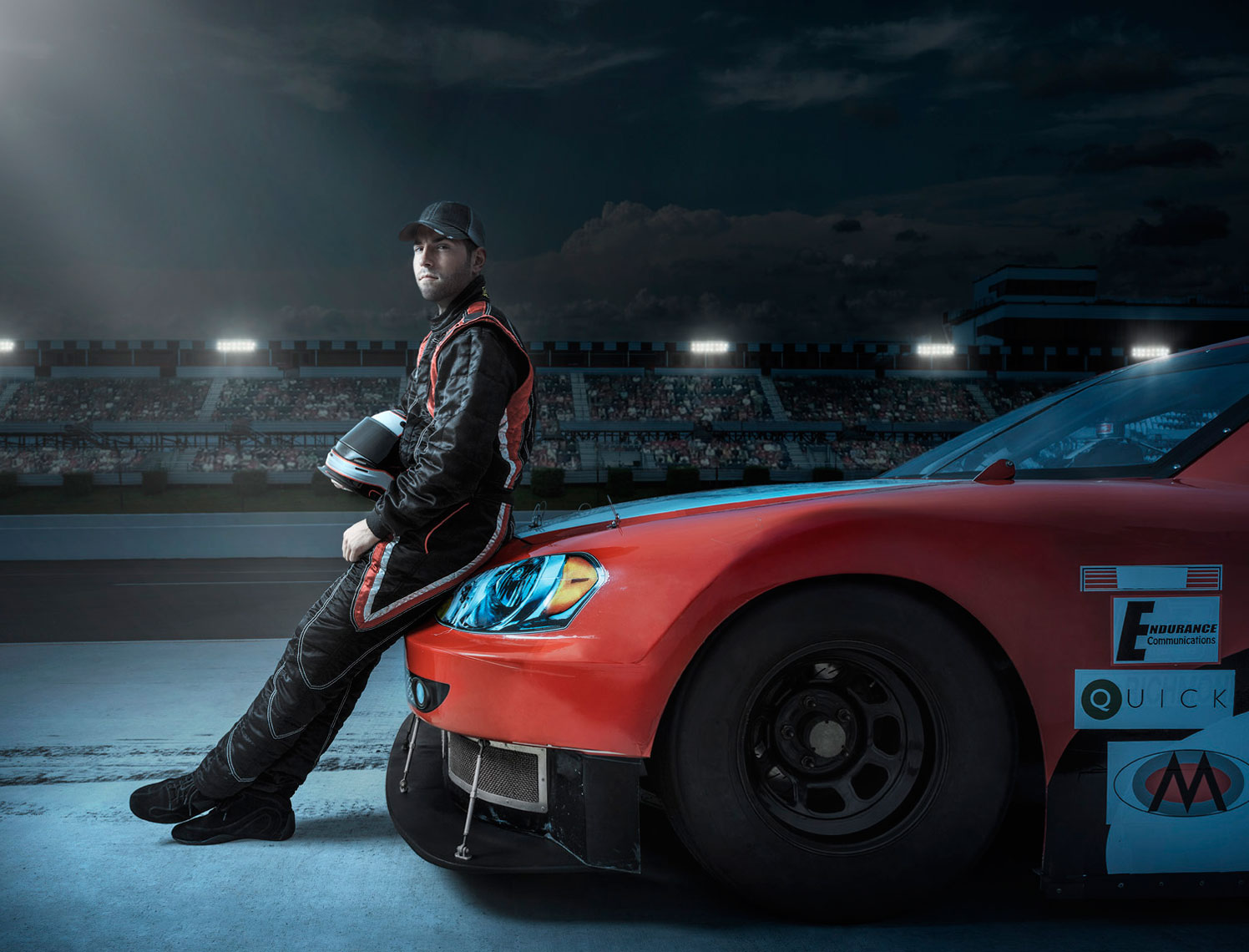 NASCAR Driver and Car Night Scene: CORBIS
