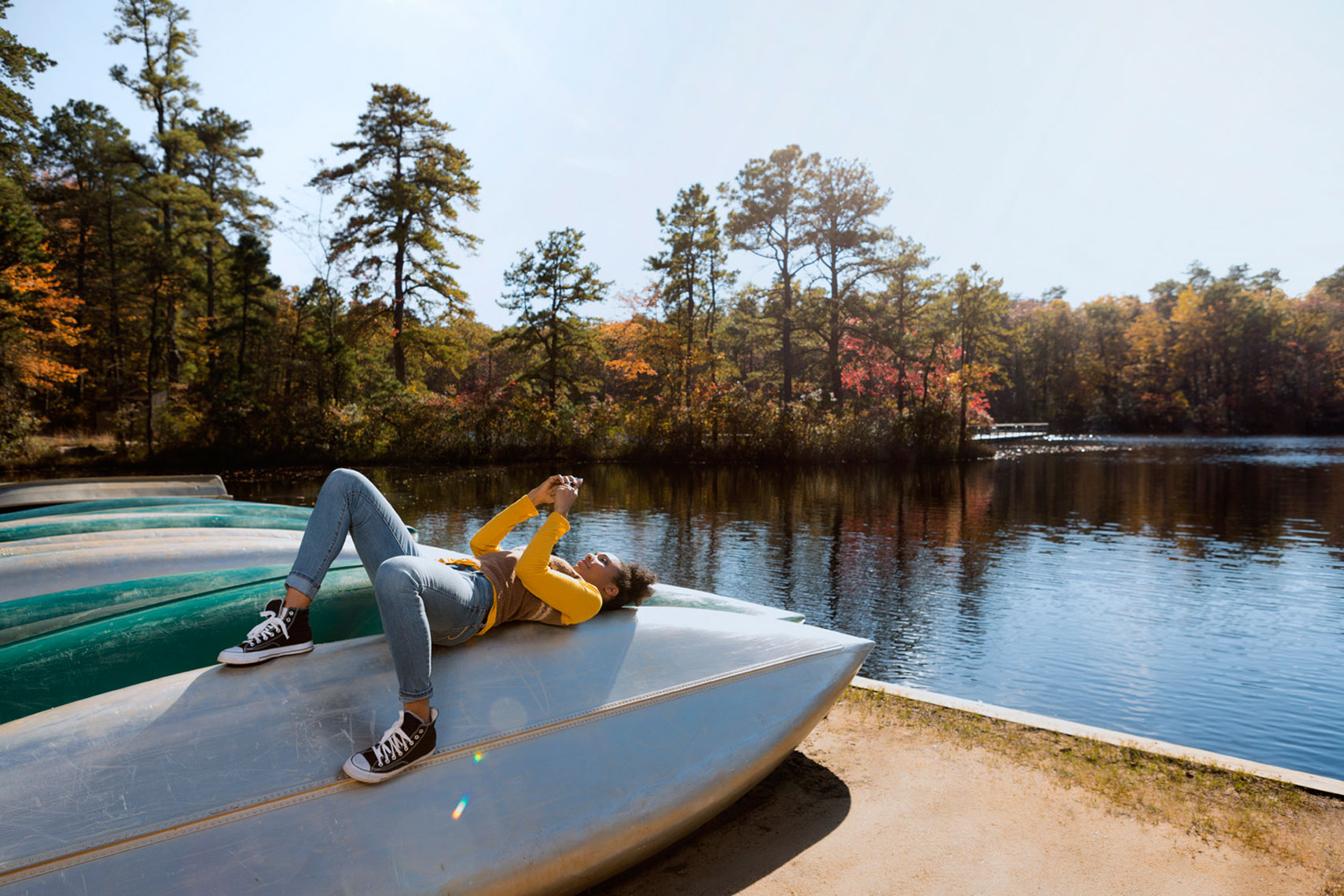 Fall Lifestyle: Young Woman on Boat Portrait: CORBIS