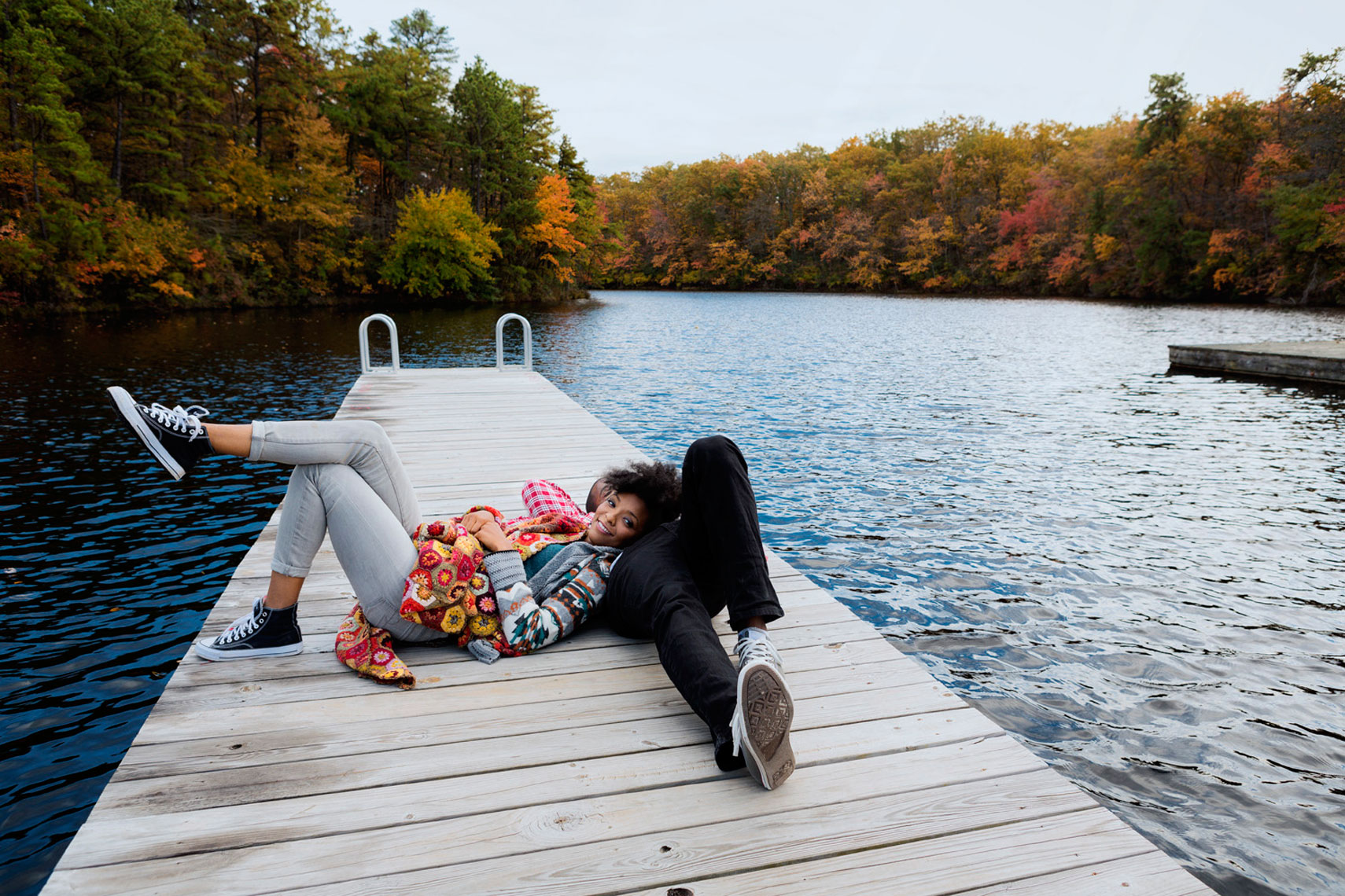 Fall Lifestyle: Couple on Dock Portrait: CORBIS