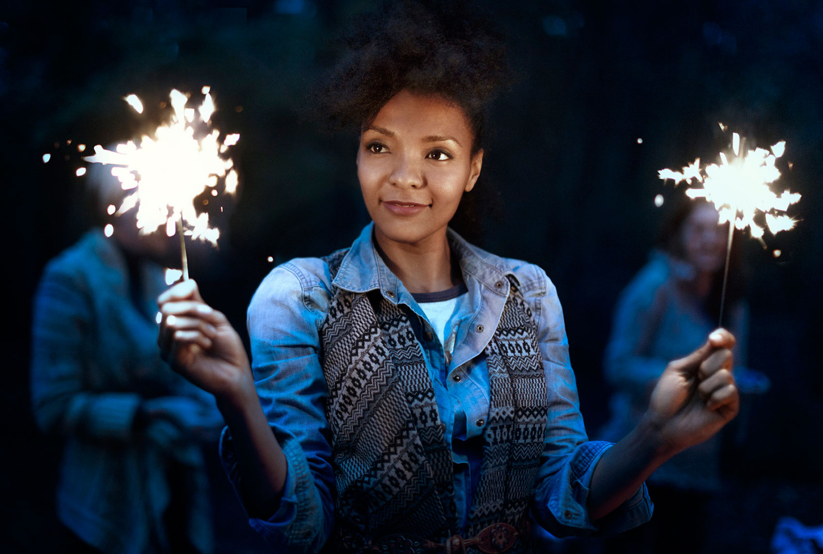 Fall Lifestyle: Young Woman with Sparks: CORBIS
